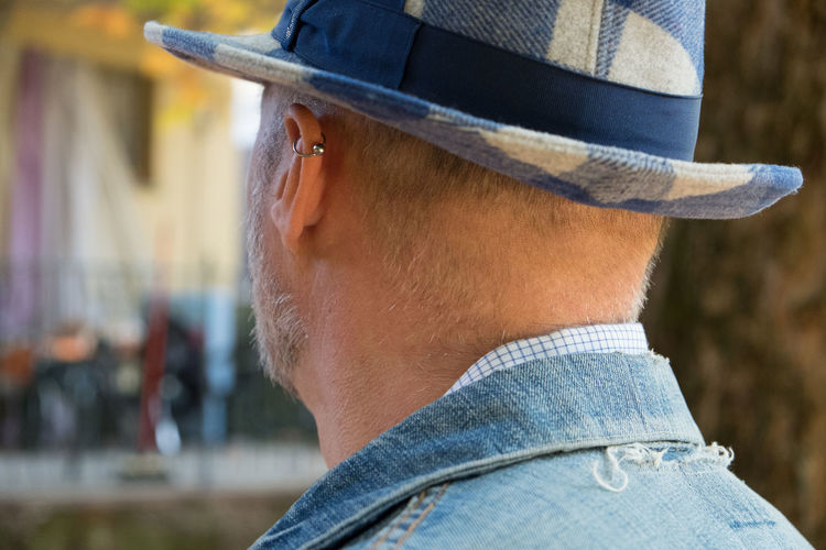 Fashion Fashion Stories Hat Squared Blue Close-up Day Focus On Foreground Headshot Human Body Part Leisure Activity Lifestyles Men One Man Only One Person Outdoors People Profile View Real People Rear View Standing