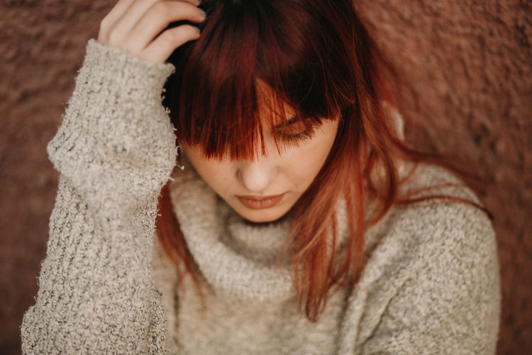 One Person Redhead Hairstyle Childhood Child Headshot Women Casual Clothing Sweater Focus On Foreground Brown Hair Portrait Indoors  Front View Emotion Real People Hair Clothing Warm Clothing Bangs Innocence