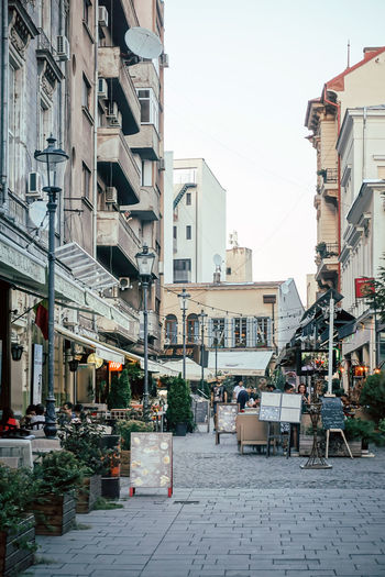 Travel Building Exterior Architecture Built Structure City Building Residential District Day Sky Incidental People Nature Outdoors Street Table City Life Cafe Seat Clear Sky Footpath Town