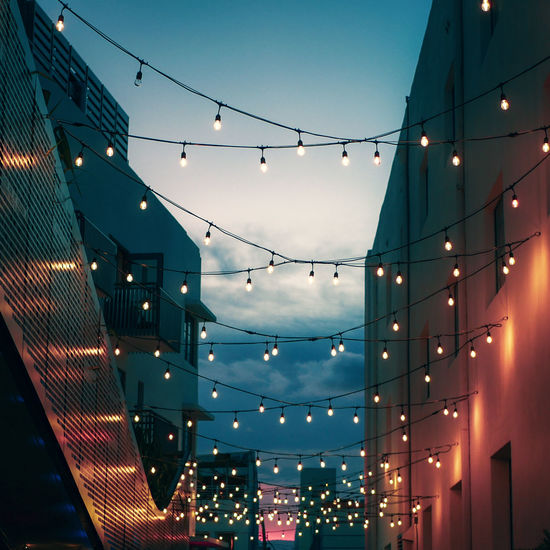 Illuminated Lighting Equipment Low Angle View Hanging Celebration Decoration No People Light Architecture Dusk Built Structure Ceiling Sky Electricity  Building Exterior Glass - Material Modern Glowing Christmas Outdoors Office Building Exterior Festival