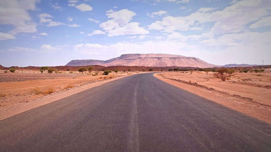Arid Climate Beauty In Nature Climate Cloud - Sky Day Desert Diminishing Perspective Direction Environment Land Landscape Mountain Nature No People Non-urban Scene Outdoors Road Scenics - Nature Sky The Way Forward Tranquil Scene Tranquility Transportation