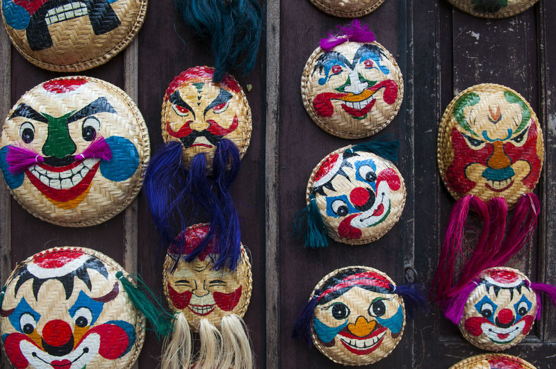 Close-Up Of Wicker Masks On Display At Market Stall