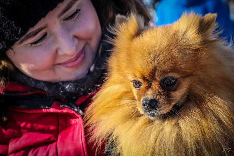 Adult Adults Only Affectionate Animal Themes Bonding Close-up Cold Temperature Cute Day Dog Domestic Animals Embracing Friendship Lifestyles Love Mammal One Animal One Person Pets Portrait Real People Smiling Warm Clothing Winter Young Adult