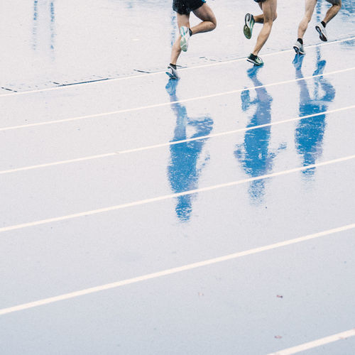 running in rain Sport Low Section Shadow Human Leg Real People Day Sunlight People Lifestyles Competition Leisure Activity Motion Track And Field Outdoors Nature Human Body Part Men Running Running Track Competitive Sport Human Foot