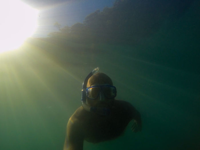 Low angle view of man snorkeling underwater