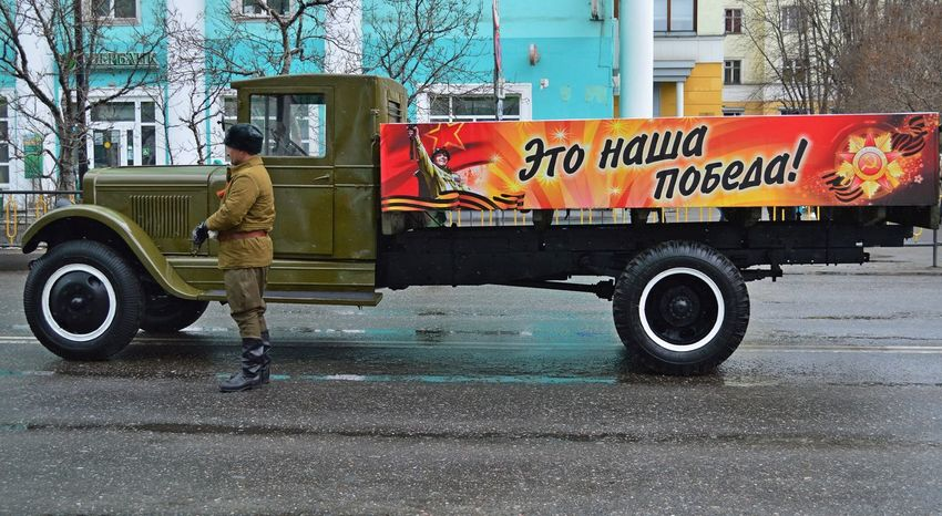 The Victory Day! Adult Architecture Building Exterior Built Structure Car City Commercial Land Vehicle Day Full Length Land Vehicle Manual Worker Men Mode Of Transport Occupation One Person Outdoors People Real People Road Street The Victory Day! Transportation Tree Working День Победы The Photojournalist - 2017 EyeEm Awards