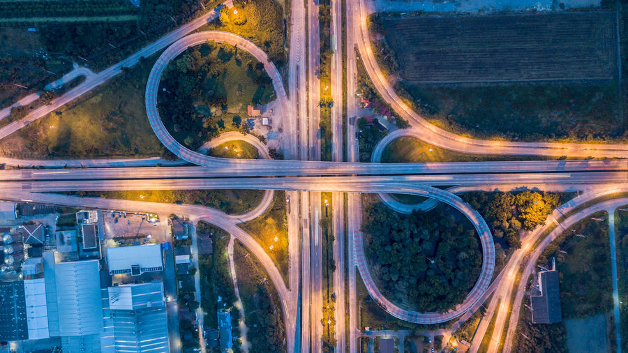 Aerial view of illuminated highways at night