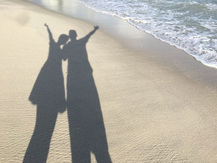 Shadow Focus On Shadow Sunlight Beach Long Shadow - Shadow Sea Sand Day Standing Leisure Activity Outdoors Real People Two People Men Wave Lifestyles Water Nature People Couple Couple Beach Photo Shadow Couple Beach Shadow