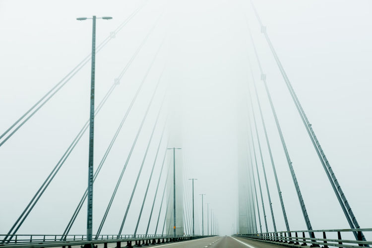 Low Angle View Of Bridge In Foggy Weather
