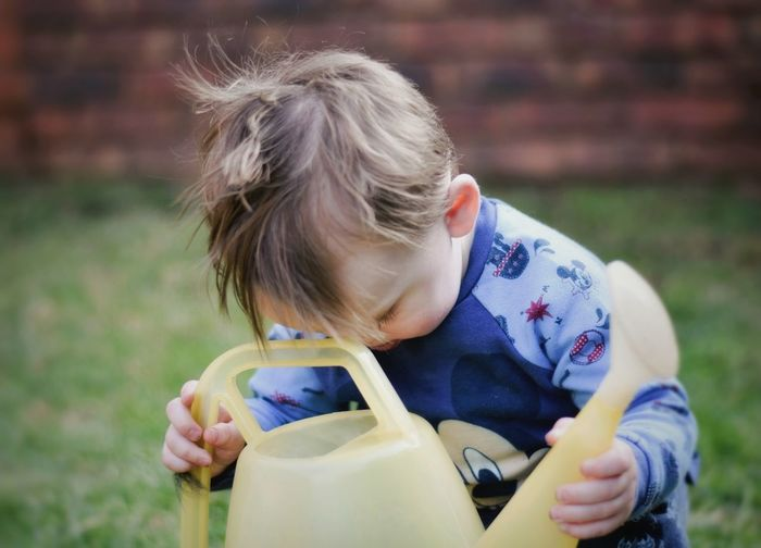 A little boy. Nikon Wateringcan Snapseed EyeEm Selects Child Childhood Drink Girls Blond Hair Headshot Water Holding Drinking Toddler