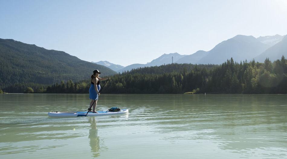 Full length of person in lake against mountain range
