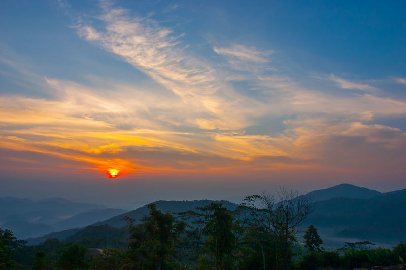 Sunset at mountain in Thailand Beauty In Nature Nature Outdoors Scenics - Nature Sky Sunset Atmospheric Mood Dramatic Sky Forked Lightning Dramatic Landscape Aurora Polaris Mountain Ridge Storm Cloud Treetop Romantic Sky Cumulus Valley Moody Sky Astronomy Sky Only Volcanic Landscape Star Field Galaxy Majestic Snowcapped Mountain Physical Geography Spiral Galaxy