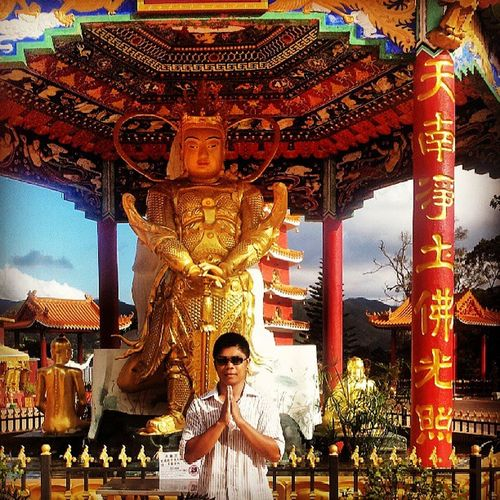 My brother taking a pose with one of the statues at the Thousandbuddhas HongKong Travelasia
