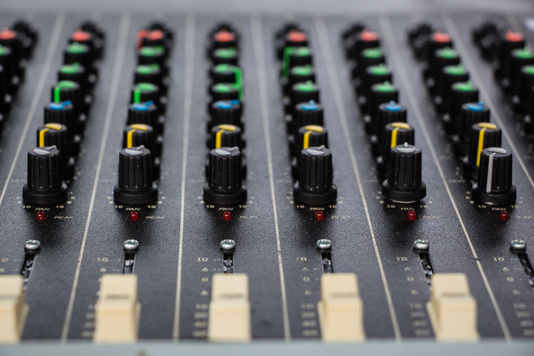 Close-up of sound mixer at recording studio