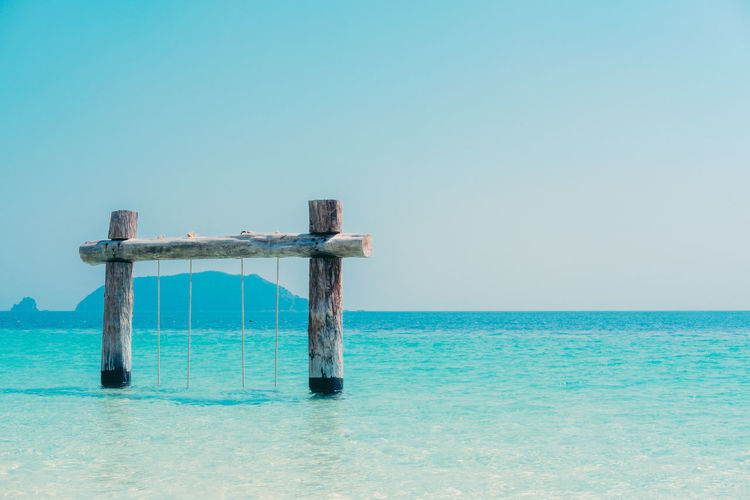 Lifeguard hut on sea against clear sky