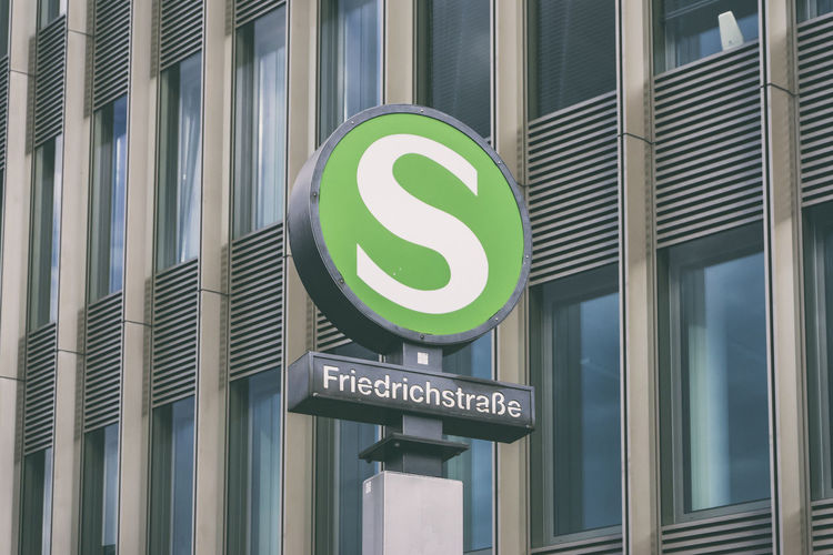 S-Bahn sign at Friedrichstrasse Station against office building facade Berlin Façade Friedrichstrasse Station Germany 🇩🇪 Deutschland Horizontal S-Bahn Berlin Sign Station Color Image No People Office Building Outdoors
