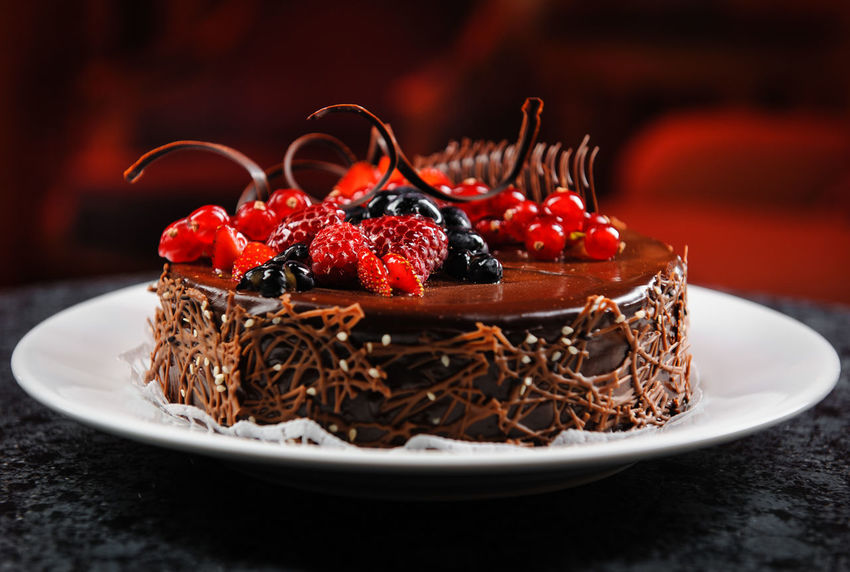 Luscious chocolate cake with fresh berries on a plate Berry Cake Chocolate Redcurrant Berry Berry Fruit Bilberries Blueberry Cake Chocolate Cake Close-up Delicious Dessert Food Food And Drink Fruit Indulgence No People Plate Raspberry Ready-to-eat Sweet Sweet Food Sweet Pie Temptation Yummy