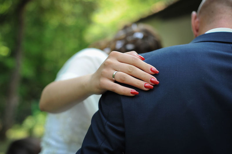 Bride Touching Shoulder Of Bridegroom