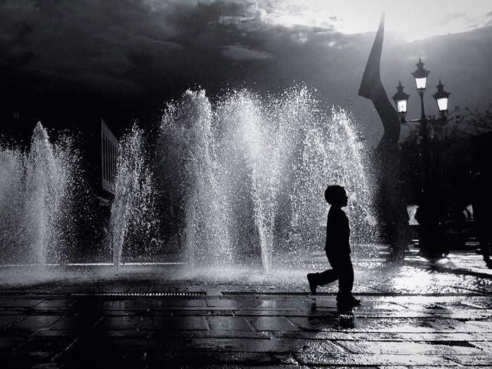 Woman enjoying fountain