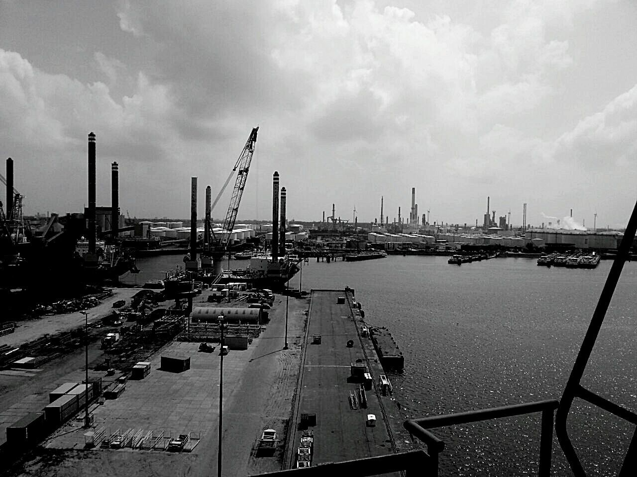 cloud - sky, sky, architecture, built structure, crane - construction machinery, city, building exterior, harbor, outdoors, freight transportation, cityscape, industry, day, commercial dock, nautical vessel, no people, water, shipyard, drilling rig