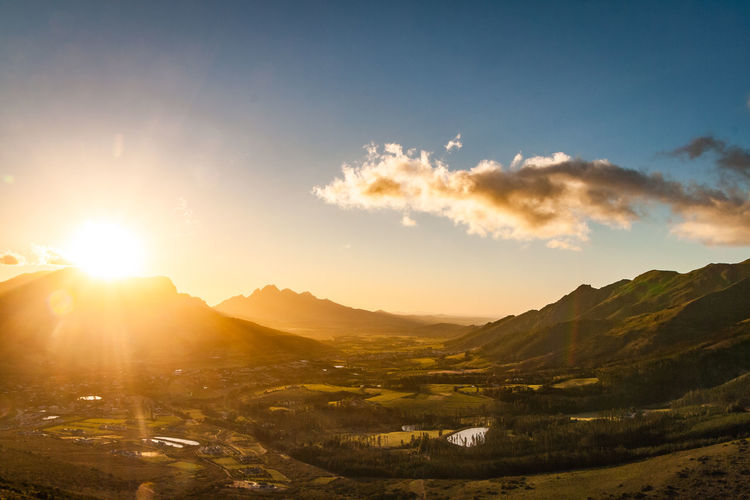 Sunset overlooking Franschoek Sky Mountain Scenics - Nature Sunlight Cloud - Sky Beauty In Nature Environment Sun Solar Flare Sunset Sunbeam Landscape Tranquil Scene Lens Flare Nature Cape Town Franschhoek Golden Hour Valley Viewpoint South Africa Mountain Range EyeEmNewHere Nature