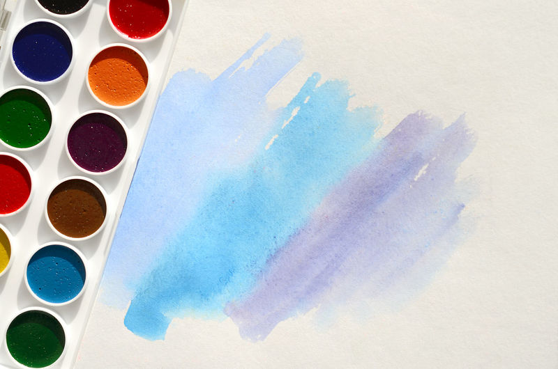 High angle view of watercolor paints on paper