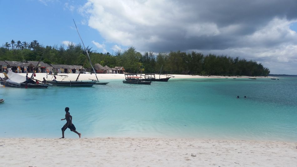 Tranquil photo of beach in Northern Zanzibar Silhouette Zanzibar Zanzibarisland Beach Beach Storm Beachphotography Beautiful Beach Beauty In Nature Blue Water Child Running Childhood Cloud - Sky Nature Outdoors Scenics Sea Sky Tranquil Beach Tropical Storm Turqouise Turqouise Water Water