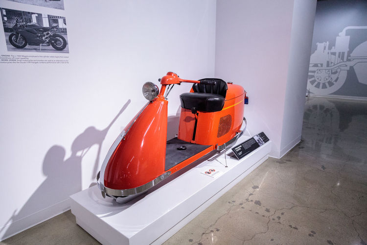 Los Angeles, CA, USA - March 4, 2017: Orange 1947 Salsbury Model 85 Streamlined scooter from Bill Kling at the Petersen Automotive Museum in Los Angeles, California, United States. Editorial only. 1947 Antique Classic Day Indoors  Model 85 No People Old Petersen Automotive Museum Salsbury Scooter Streamlined Transportation Vintage