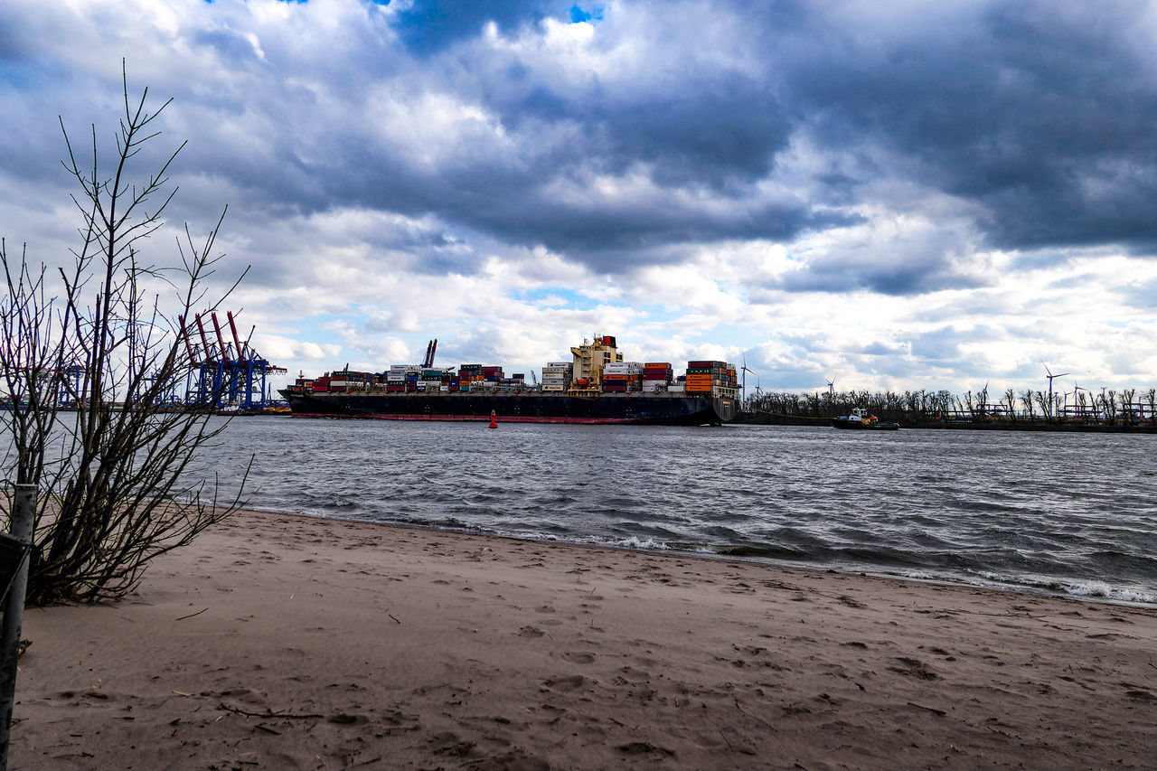 cloud - sky, sky, water, architecture, sea, nature, transportation, built structure, nautical vessel, building exterior, freight transportation, land, shipping, city, mode of transportation, beach, no people, ship, outdoors