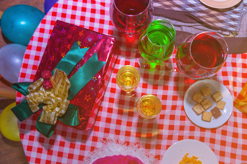 High angle view of multi colored bottles on table