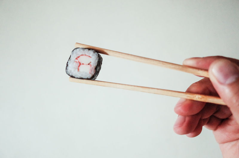 Chopsticks Close-up Food Fresh Freshness Holding Human Body Part Human Hand Japanese  One Man Only One Person People Ready-to-eat Sushi White Background