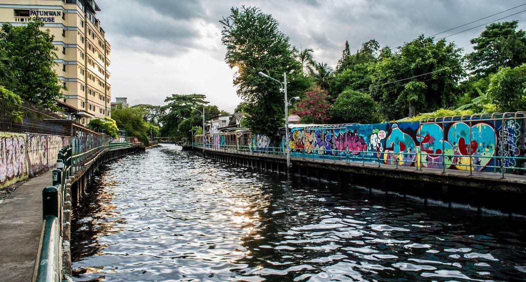 Street art beside canal Architecture Art Art Work Bangkok Built Structure Canal Decoration Design Graffiti Modern Nice Path Pathway Sky Street Art Street Art/Graffiti Street Arts  Sunset Tree Tree Urban View Water Wave Way