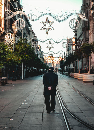 Wise oldman walking through the Sevilla street, down the christmas decoration One Person Adult Street Footpath Warm Clothing Outdoors Incidental People The Way Forward Walking Alone Oldman Center Centered Center Focus Real People Direction Sevilla Seville Sevilla Spain SPAIN Spain♥ Christmas Decoration Christmas Christmas Lights