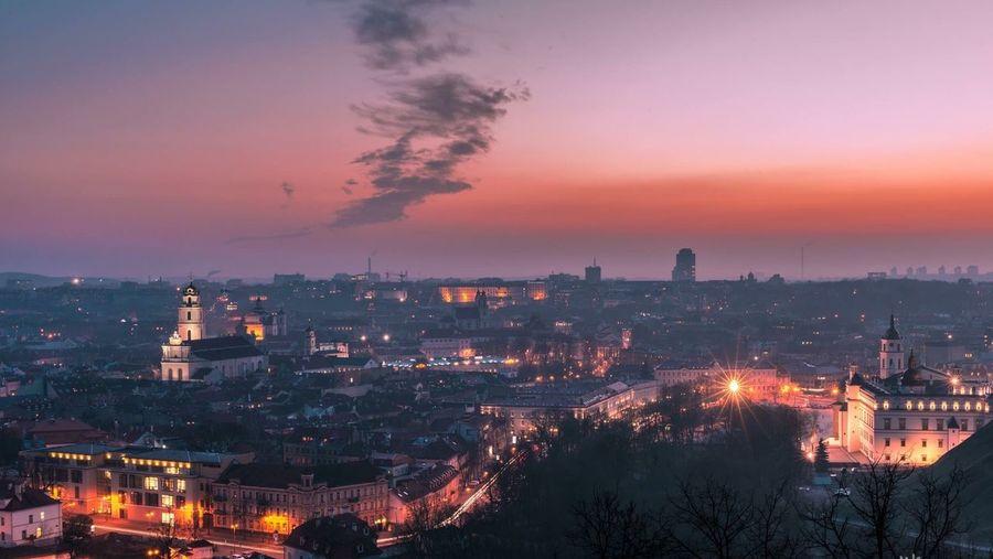 Illuminated Cityscape Against Sky During Twilight