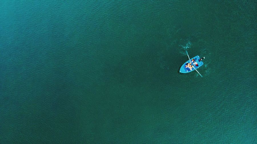 High Angle View Of Man In Rowboat At Sea