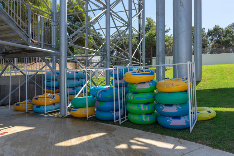 Sliding Swimming Absence Architecture Blue Building Exterior Built Structure Day Green Color Large Group Of Objects Metal Multi Colored Nature No People Outdoors Pipe - Tube Plastic Ring Shadow Slide Slide - Play Equipment Summer Sunlight Swimming Pool Yellow