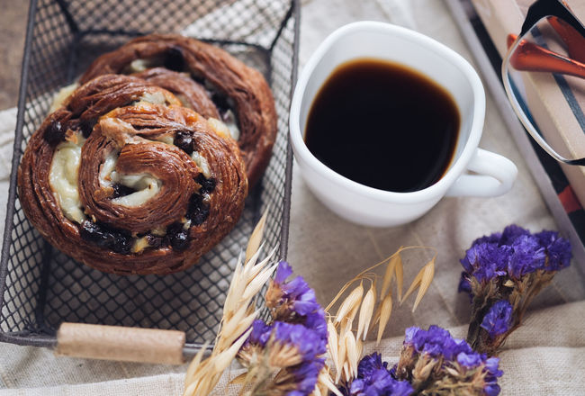 Baked Pastry Item Black Coffee Book Chocolate Chocolate Croissant Close-up Coffee Coffee Cup Decoration Eyeglasses  Eyesight Flower Food Food And Drink Freshness Indoors  Leisure Activity Lifestyles No People Reading Ready-to-eat Refreshment Still Life Sweet Food Table