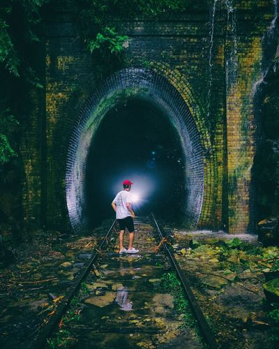 Absorb Glowworms Waterfall Tracks Blue Heritage Old Tunnel Train Explore Adventure Hike Australia Nsw Full Length Real People One Person Leisure Activity Casual Clothing Rear View Lifestyles Standing Childhood Men Nature Outdoors Green Color Day Plant Architecture Enjoyment