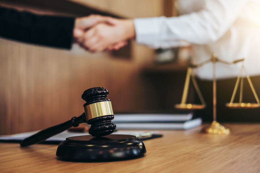 Lawyer Balance Barrister Business Business Person Corporate Business Counselor Fairness Gavel Hand Human Body Part Human Hand Indoors  Judge Judgement Justice Legal Legislation Office One Person Sitting Verdict Women Wood Wood - Material