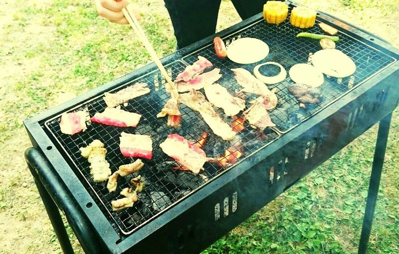 Barbecue Grill Barbecue Grilled Outdoors Meat Preparation  High Angle View Food And Drink Day Burning Heat - Temperature Smoke - Physical Structure Freshness Summer Chef