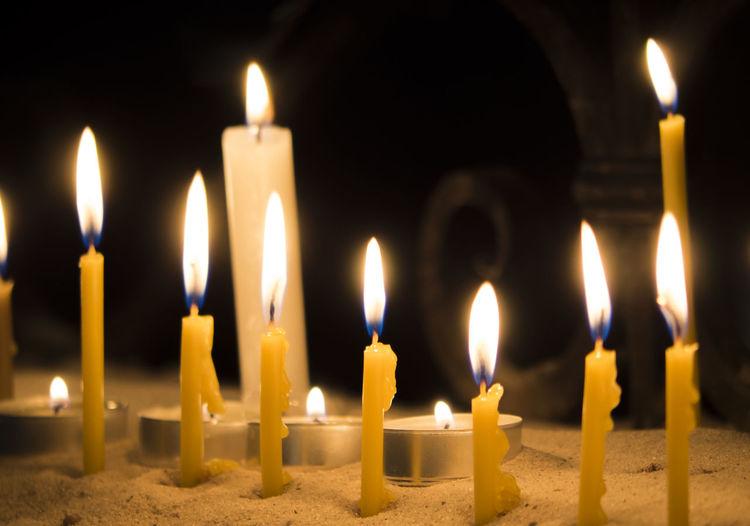 Close-Up Of Burning Candles At Church