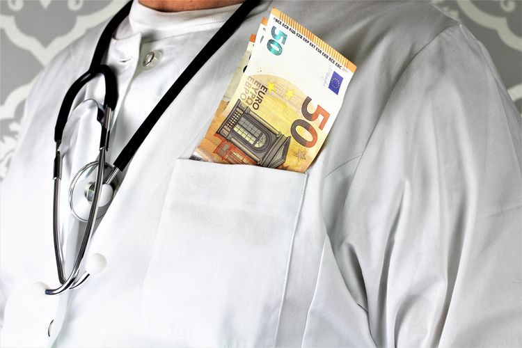 An Image of a corrupt doctor with money Cash Corruptible Corruption Curruption Doctor  Europe Healthcare Healthy Eating Money