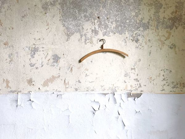 Hanger Clothes Hanger Backgrounds Historical Building Architectural Detail Yellow Color Plaster Building Interior Renovation Wall Wall - Building Feature No People Indoors  Day Built Structure Full Frame Concrete