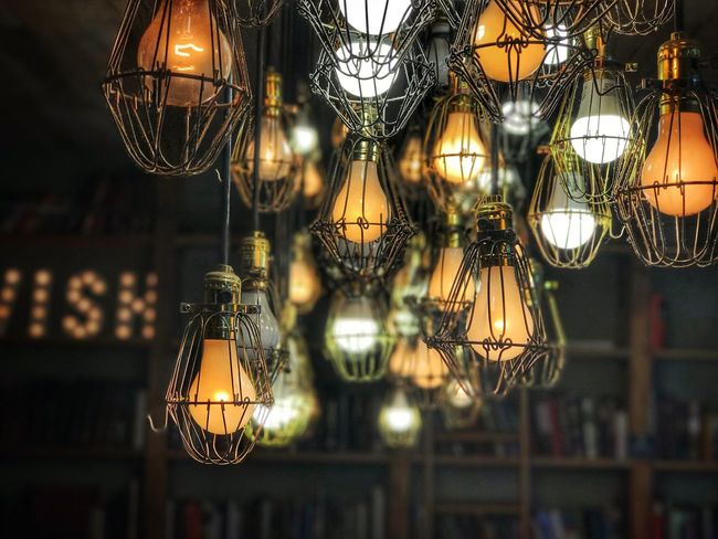Hanging Lighting Equipment Illuminated Indoors  Electricity  Light Bulb Night No People Lantern Large Group Of Objects Focus On Foreground Low Angle View Close-up New York