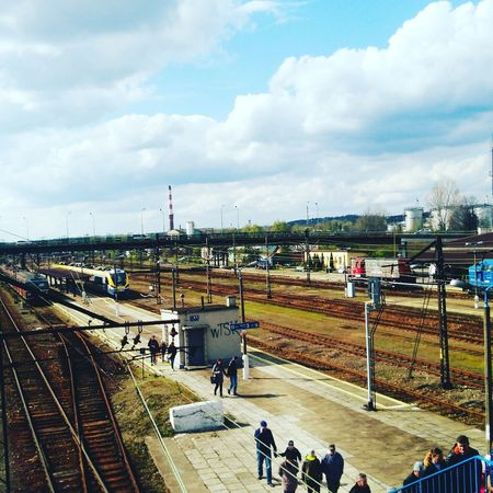 City Cloud - Sky Day High Angle View Large Group Of People Lenovotography Outdoors People Poland Pollen Public Transportation Rail Transportation Railroad Station Railroad Track Sky Sports Track Train - Vehicle Transportation Trzebinia