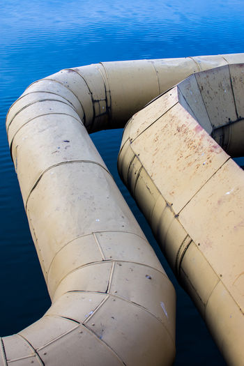 High angle view of pipe by swimming pool