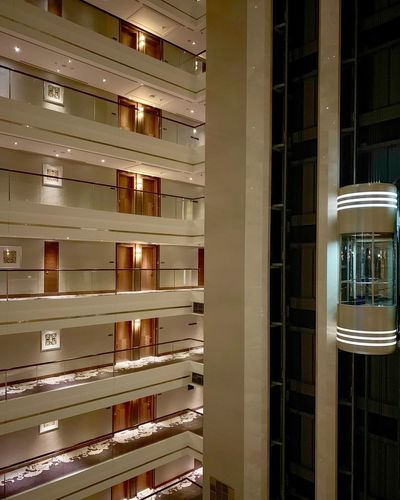 Among floors... No People Architecture Building Built Structure Wood - Material Building Exterior Glass - Material In A Row Large Group Of Objects Arrangement Shelf Illuminated Wall - Building Feature Full Frame Pattern