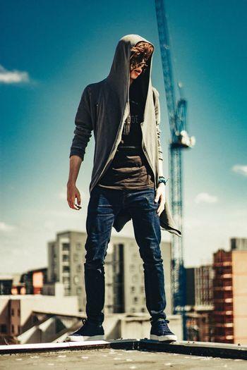 Full length of man standing on building terrace