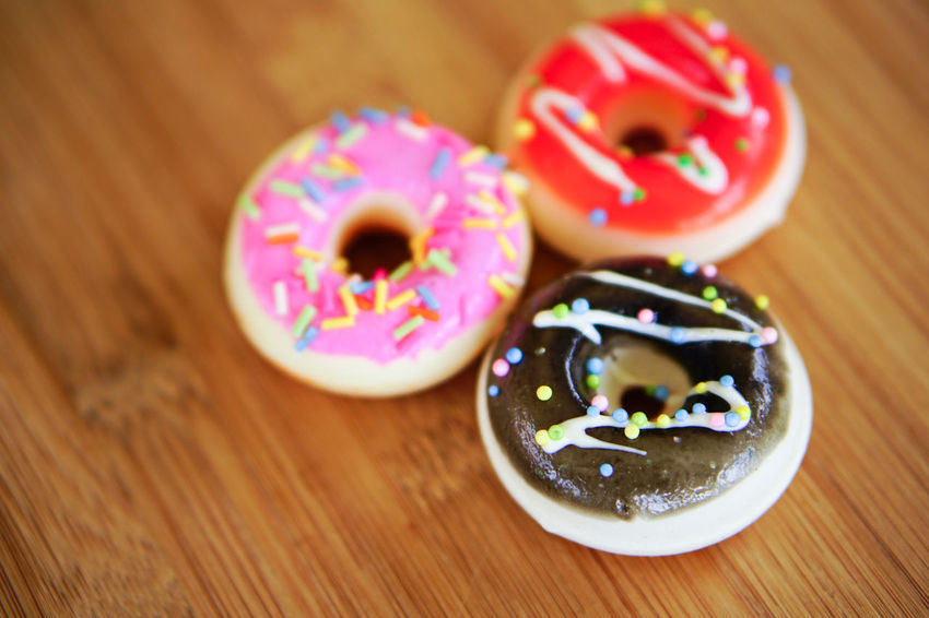 Food Food And Drink Sweet Food Sweet Indulgence Freshness Wood - Material Dessert Donut Baked Multi Colored Sprinkles No People Close-up Indoors  Temptation Unhealthy Eating Icing Still Life Table Snack Convenience Food Dieting