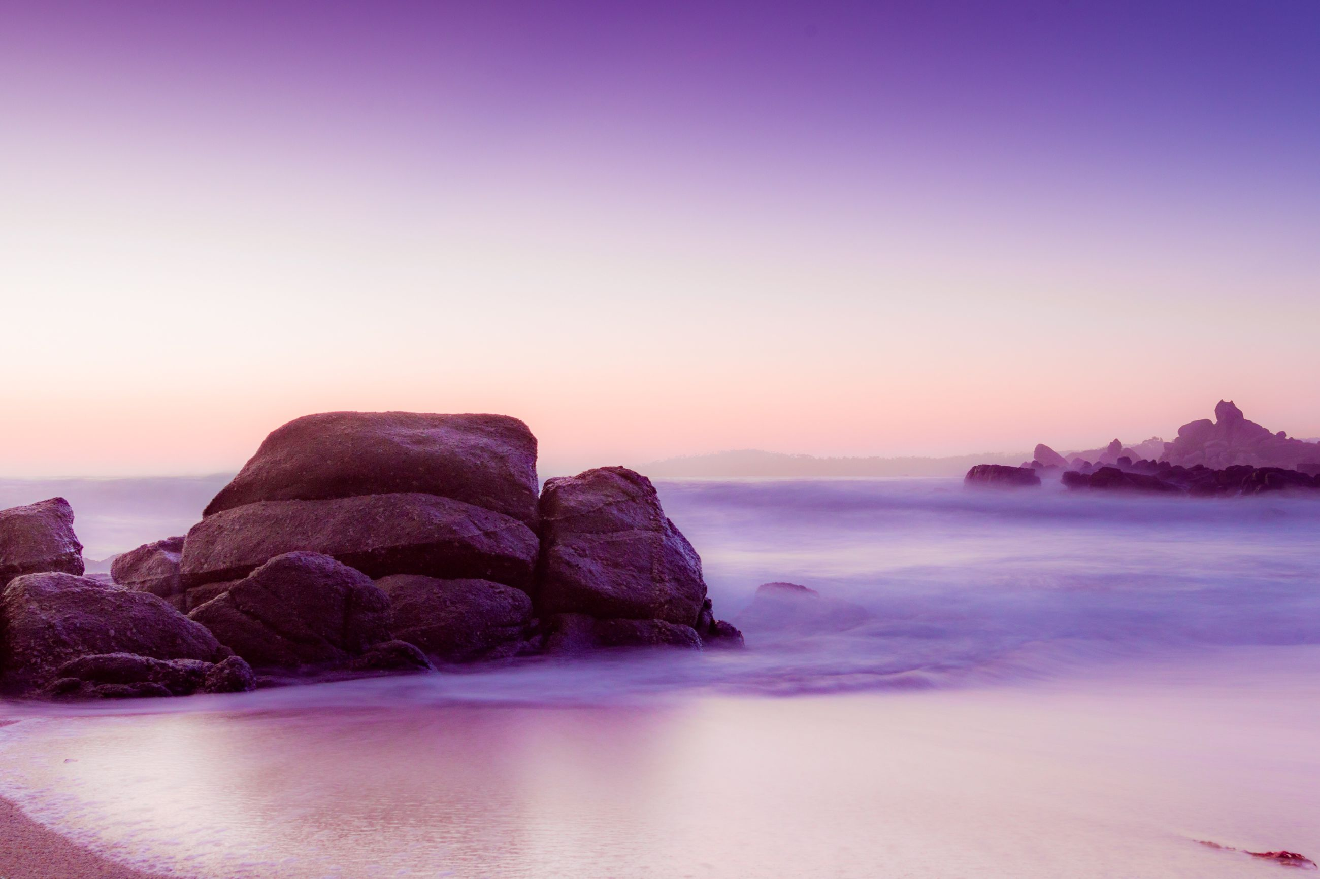 sea, nature, tranquility, scenics, sunset, tranquil scene, beauty in nature, water, purple, idyllic, sky, clear sky, rock - object, no people, outdoors, horizon over water, day
